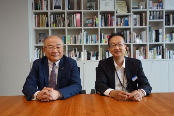 浅羽信行常務執行役員(左)と中島孝浩事業企画本部長